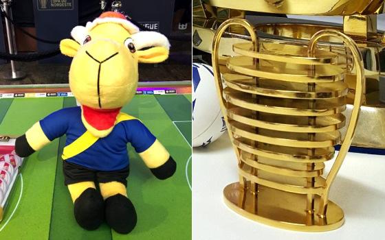 Mascote de pelúcia e réplica da taça da Copa do Nordeste. Fotos: Bruno Reis/EI e Cassio Zirpoli/DP